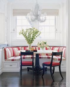 breakfast nook idea.  I like the crescent shaped bench and cabinets to the left over the bench.