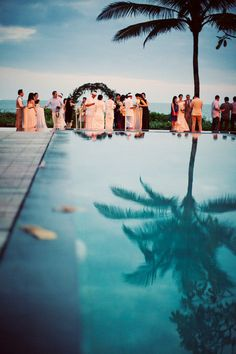 Reflections of a stunning wedding in pool, paradise