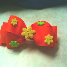 Just add buttons to a solid color hair bow.