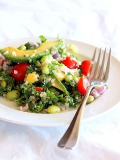 [ Recipe: Kale, Edamame, and Quinoa Salad with Lemon Vinaigrette ] Made with: quinoa, edamame beans (cooked & cooled), Tuscan kale, grape tomatoes, red onion, mango, avocado, toasted almonds (or pumpkin seeds). Lemon vinaigrette dressing made with: olive oil, fresh squeezed lemon juice, garlic, sugar, basil, salt, and fresh ground pepper. ~ from Ambitious Kitchen