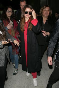 On her way to Paris, Selena Gomez wore what looks to be the most comfortable airport outfit ever.