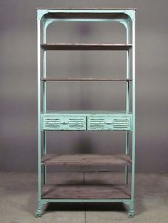 look drawn straight from a 1940′s drugstore or dime store fixture, the george street rack in soft mint painted metal with ashy wooden shelves says industrial + whimsy in one. this perfect kitchen, office, bath or spa shelving can transform into a tidy media rack in seconds. remove the sec