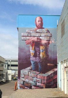 """The Wall Builder""  Tauranga, New Zealand: new piece by Australian street artist Fintan Magee for Paradox festival."