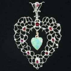 Silver Victorian Flemish heart pendant with rubies and heart shaped opal
