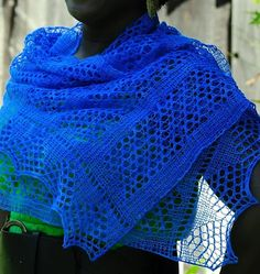 Free Knitting Pattern on One Skein Melody's Stole - This lace rectangular wrap is easily adapted to a wider and longer shawl by casting on more stitches and working more repeats. The edging is worked at the same time as the main body. Designed by Denise Twum. 21″ x 61″. Pictured project used 400-500 yards of lace yarn.