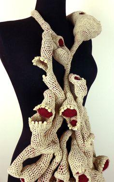 """Intestine Necklace""Crocheted linen, felted wool, false teeth 2013 32x12x15"" 81x30x38cm"