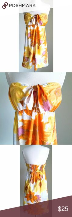 """🆕 J Crew Strapless Yellow Orange Floral Sundress Yellow, orange, white, and brown sunflower pattern. Elastic back. Tie front bust with key hole opening. Tag says XS, but fits like Small. Full cotton lining. Length (top of bust to hem)- 28"""", Bust- 34"""" (slightly adjustable with tie front), Band under bust (before stretched)- 28"""", Waist- 38"""", Hip- 42"""". Machine wash, tumble dry. 100% cotton. Gently used condition (slight wear from washing) J. Crew Dresses Strapless"""