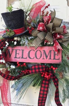 This Cozy and Happy Christmas Wreath is made on a Pine Base. I have Layered it with an Assortment of Pine, Frosted and Icy Pine and Red and White Berries. I Added a Wooden Rustic Look Welcome Sign and the Cutest Sparkly Snowman Hat. I Finished out the Wreath with an Assortment of