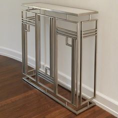 Inspired by Deco architecture and sky scrapers the Harrison console is a handsome addition to urban decors. Silver forged iron with white honed marble top.