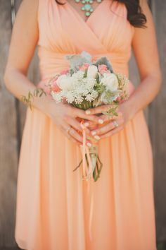 Peachy bridesmaid | Photography: Nessa K Photography - nessakblog.com  Read More: http://www.stylemepretty.com/2014/05/30/romantic-woodlawn-bed-breakfast-wedding/