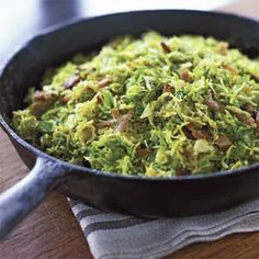 """Slice the brussels sprouts very thinly to make them extra-tender. Pancetta is a classic pairing. Prep and Cook Time: 45 minutes. Notes: A mandoline works well for """"shaving"""" the brussels sprouts. Use a fork stuck in the core end of the sprout to keep your fingers away from the blade."""