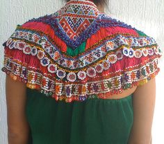 This cape is perfect for warding off sunburn. Easy to make from t-shirt top portion and odd trims. Burning Man.