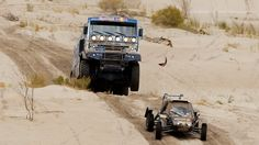 "Rawr. ""Red Bull Kamaz rally truck getting ready to eat a buggy somewhere in the Argentinian desert."""