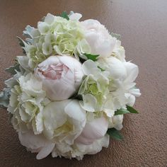 White and tint of soft pink peonies with hydrangeas