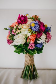 Summer Wedding Ideas.  Create a gorgeous bouquet with bright summer flowers.  You can use silk flowers to recreate this look and save money.  Find high-quality silk roses and preserved billy buttons at Afloral.com.  Pinned by Afloral.com from http://www.stylemepretty.com/gallery/picture/1393816/
