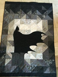 Batman Quilt...based on an art print. HST blocks with Batman Silhouette appliqué