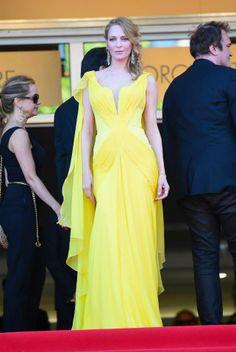 "Uma Thurman - in a canary yellow Atelier Versace gown, custom made for the premiere of ""Clouds of Sils Maria"" at the 67th Annual Cannes Film Festival! #VersaceCelebrities #AtelierVersace"