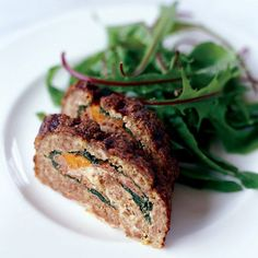 """Meat Loaf Stuffed with Prosciutto and Spinach   This luxurious yet easy take on classic meat loaf gets stuffed with spinach, carrots, prosciutto and cheese. The vegetables can be leftovers, says Mario Batali: """"Just make sure they're cooked long enough to be very soft--if they're al dente, the meat loaf will tear when you slice it and wreck your day."""" Mild and tangy caciocavallo cheese, made in Italy from cow's milk, is excellent in the filling, but provolone is a fine substitute."""