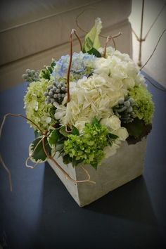 A classic hydrangea centerpiece with brunia berries and curly willow.
