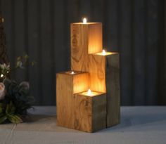 """Reclaimed Wooden Cube Candle Holder Set of FOUR Tealight Holders Approx Measurements: 3-10"""" in Height Varying heights 2"""" Diameter May have knots, cracks or imperfections. Looking to add some texture t"""