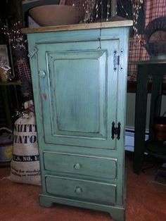 Chimney cabinet in sage green by Winks Wood Barn