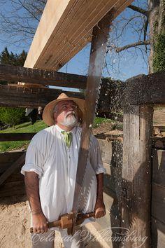 Carpenter pit sawing.