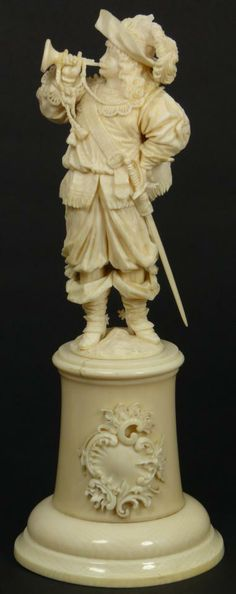 CONTINENTAL IVORY FIGURE OF CAVALIER BLOWING HORN  Exquisite continental ivory depicting an English Cavalier or French Royal Musketeer. Fine detail throughout. Has ivory base with scrolled plaque to front. 19th century.
