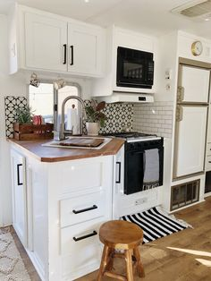 Arrows and Bow Tiny RV Kitchen - Renovated Trailer