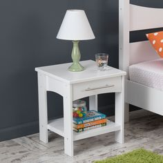 Designed on a scale perfect for your child's bedroom, this wooden night stand features two surfaces for a clock, table lamp and bedtime reading. The clean-lined side table comes in white or espresso, making it suitable for any decor.
