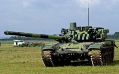 """T72 tank  TH - note those boxes on the surface of the tank, that is likely reactive armor, or armor that """"counter explodes"""" to defeat an attack."""
