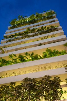 Stacking Green | by Vo Trong Nghia Architects. This green facade and roof garden protect its inhabitants from direct sunlight, street noise and pollution. To water plants, the automatic irrigation pipes inside the planters were installed. Rainwater is collected in the tank and pumped up for this irrigation system.