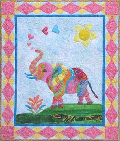 "Miss Ellie Soleil, 26 x 31"", is a delightful colorful elephant that is enjoying the sunshine blowing hearts of love for everyone.  Applique pattern by Barbara Bieraugel Designs"