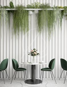 Lush indoor plants bring life to the textured white wall and complement the contemporary dark green chairs, the lounge café design brings together organic shapes and elements with modern and minimal i Coffee Shop Interior Design, Coffee Shop Design, Restaurant Interior Design, Modern Interior Design, Contemporary Interior, Interior Logo, Commercial Interior Design, Café Design, Design Lounge