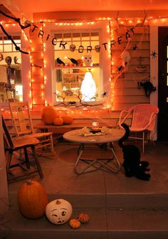 Halloween front porch decorations lights black cats pumpkings trick or treat!