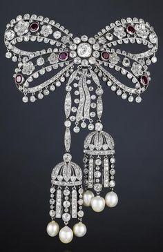 A fine belle époque diamond, ruby and pearl devant de corsage, by Cartier, circa 1910