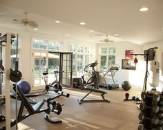 Home gym design idea. i like the punching bag, the doors and windows