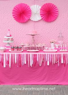 Pretty in pink birthday party- ribbon banner on front edge of table