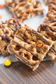 Chocolate and peanut butter pretzel bars with Reese's pieces candy are one of our favorite simple, sweet and salty treats! | tastesbetterfromscratch.com