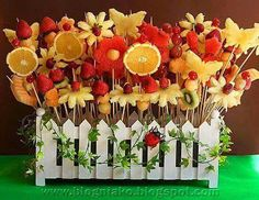 Superbe... Cheery fruit display, white picket fence garden...