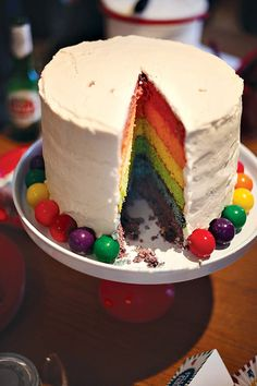 Possibly a rainbow cake for the Carnival party? Or even just red and white layers to match the red/white striped theme?