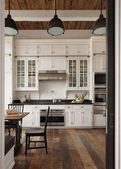 I like the rail between the top cabinet and the glass cabinets. You could hook a ladder to reach the top cabinets!!