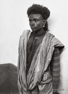 Gorgeous man.    Portrait of a Bisharin male, Egypt, 1900-1920.