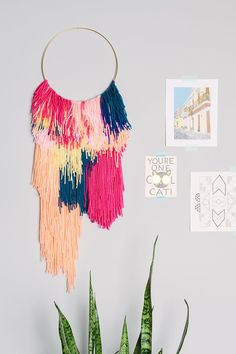 Create a colorful, woven wall hanging yourself by following this simple tutorial.