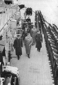 Adolf Hitler inspecting the battleship Bismarck with Admiral Lutjens and Captain Lindemann, Gotenhafen, Germany (now Gdynia, Poland), 5 May 1941. Hitler was not a sea person and had a rather low opinion of sea power. As a result, navy chiefs had to work very hard to secure resources for the naval arm throughout the war.