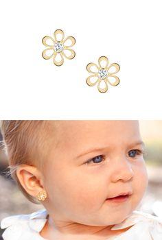 Flower silhouette baby earrings in solid 14k gold.