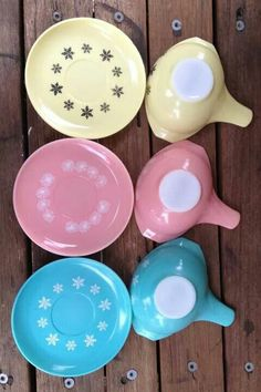 Pyrex gravy handled boats with their matching saucers... pink daisy, turquoise snowflake and yellow snowflake...