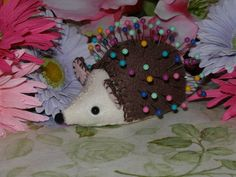 "Craftster user KimsCozyKitchen created this hedgehog pincushion from a vintage pattern (which you can find online here). I love his candy-colored ""needles""."