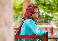 A portrait of 16-year-old Yusra Suleiman al Toum Ahmed in El Fasher, Sudan. Ms. Ahmed, an aspiring journalist, is a member of her country's Parliament of Students, Quranic organization and Students' Union. 8 August 2011. El Fasher, Sudan. UN Photo/Albert Gonzalez Farran
