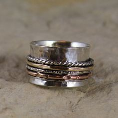 Low Profile Sterling Silver Spinner Ring With Sterling Silver, Copper and Bronze accent spinners    http://www.etsy.com/listing/71607205/low-profile-spinner-ring