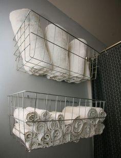 screw wire baskets to wall = instant towel storage!